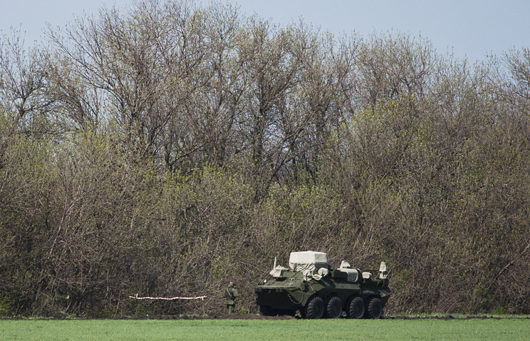 Russian soldier patrols near army vehicle not far from the Novoshakhtinsk checkpoint's customs station