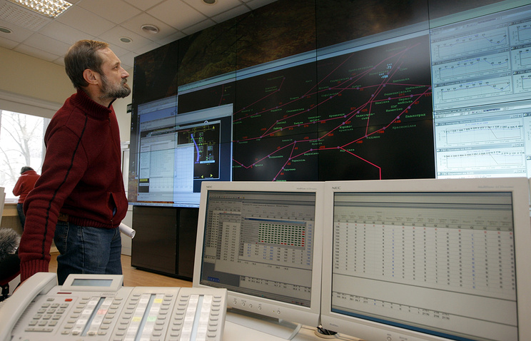 An operator watches the screens at the control center of Ukrainian gas transportation company