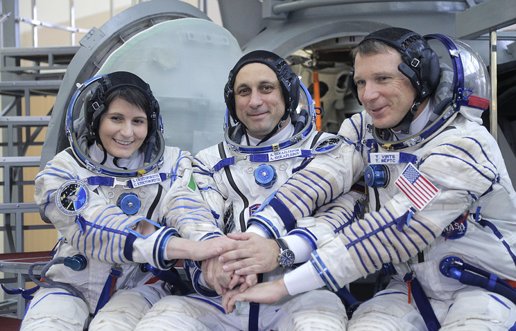 Members of main crew expedition 42/43 to ISS Italian astronaut Samantha Cristoforetti, Russian cosmonaut Anton Shkaplerov and US astronaut Terry Virts