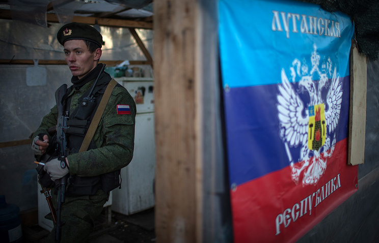 A soldier at a checkpoint in Luhansk region