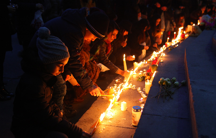 Armenian people light candles in Yerevan in memory of a family slain in Gyumri, Armenia