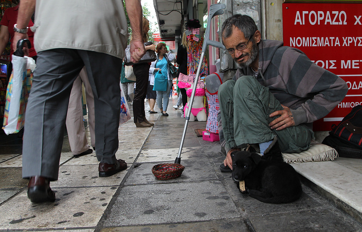Man begging for money in the port city of Thessaloniki, Greece