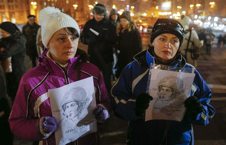 Participants of a rally hold portraits of Nadezhda Savchenko
