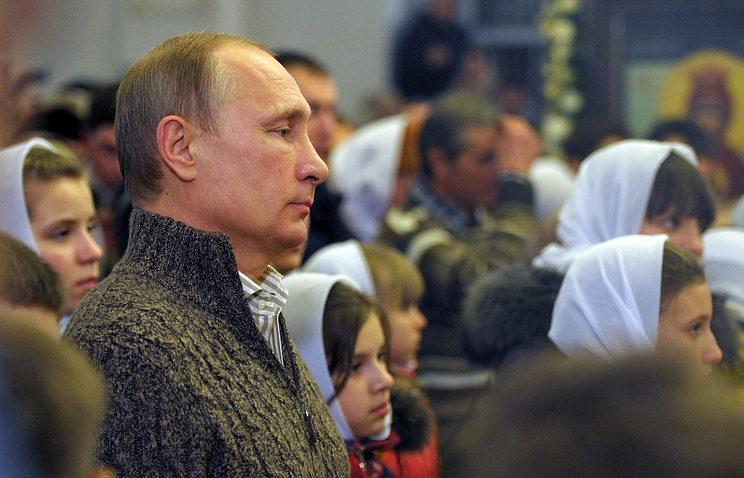 Vladimir Putin in church