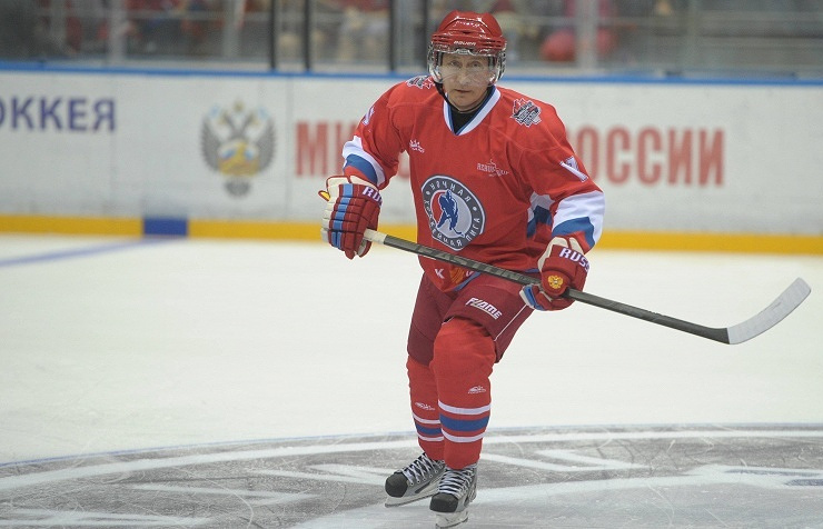 Vladimir Putin playing ice hockey (archive)