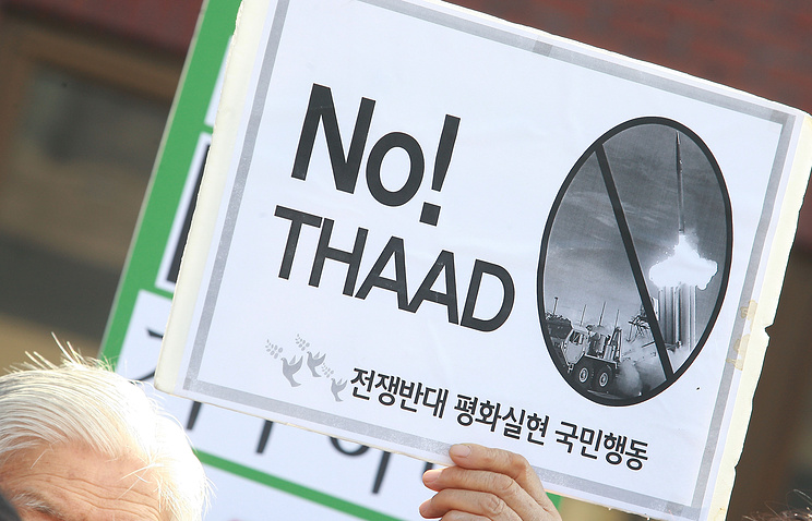 A rally against government's military policy near the presidential house in Seoul, South Korea