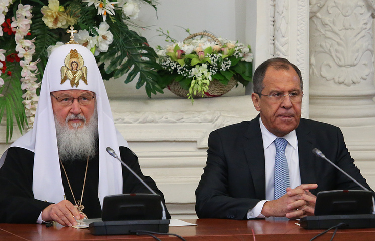 Russian foreign Minister Sergey Lavrov (right) and Patriarch Kirill of Moscow and All Russia