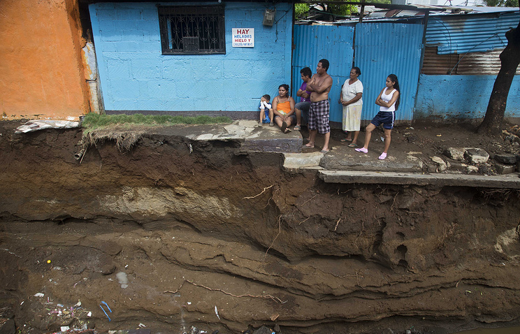 Street destroyed by heavy rain in Managua, Nicaragua