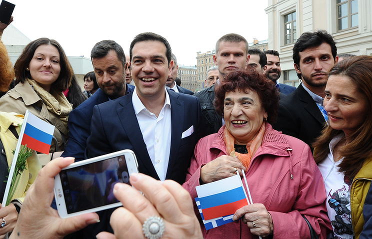 Greek Prime Minister Alexis Tsipras (center) in St. Petersburg