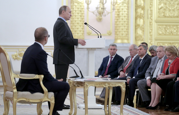 Russian President Vladimir Putin at a plenary session of Russia's Civic Chamber