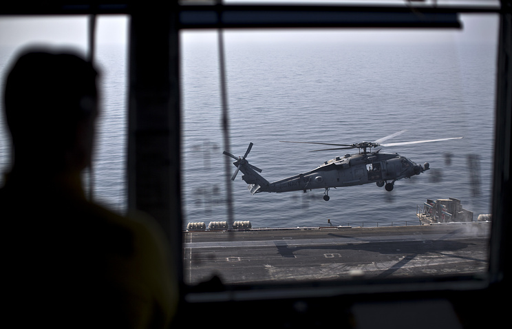 US Navy at the Primary Air Control aboard the USS Theodore Roosevelt aircraft carrier, deployed in the Persian Gulf