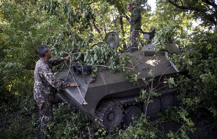 Camouflaged Ukrainian armored military vehicle (archive)