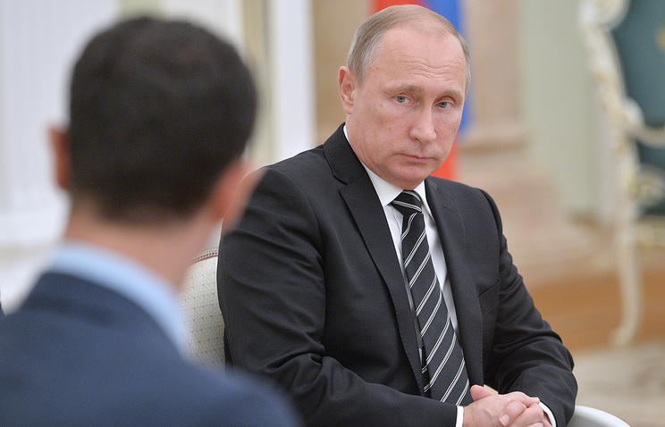 Russian President Vladimir Putin at a meeting with his Syrian counterpart Bashar al-Assad
