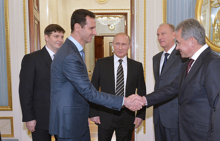 Syria's President Bashar al-Assad, Russia's President Vladimir Putin, Russian Security Council Secretary Nikolai Patrushev and Russia's Defense Minister Sergei Shoigu during a meeting at Moscow's Kremlin