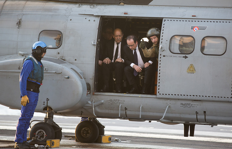 France's President, Francois Hollande arriving on the the Charles De Gaulle aircraft carrier