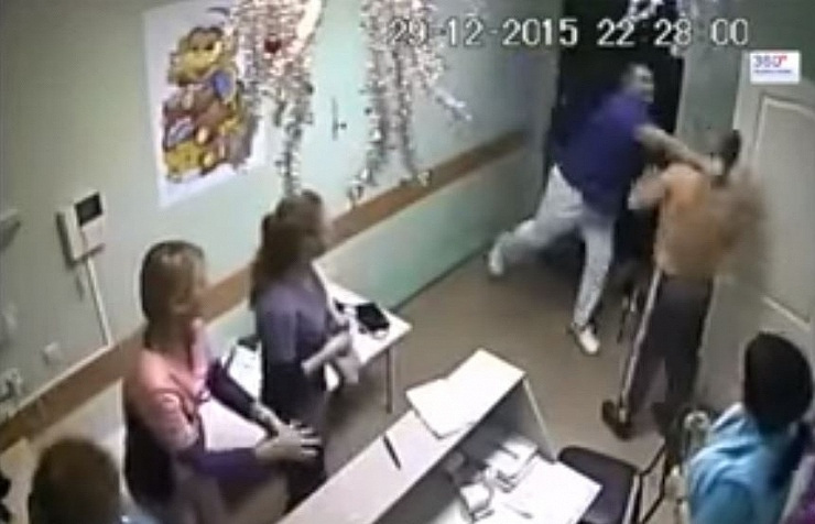 A screeshot from a surveillance video showing the moment of the tragic blow