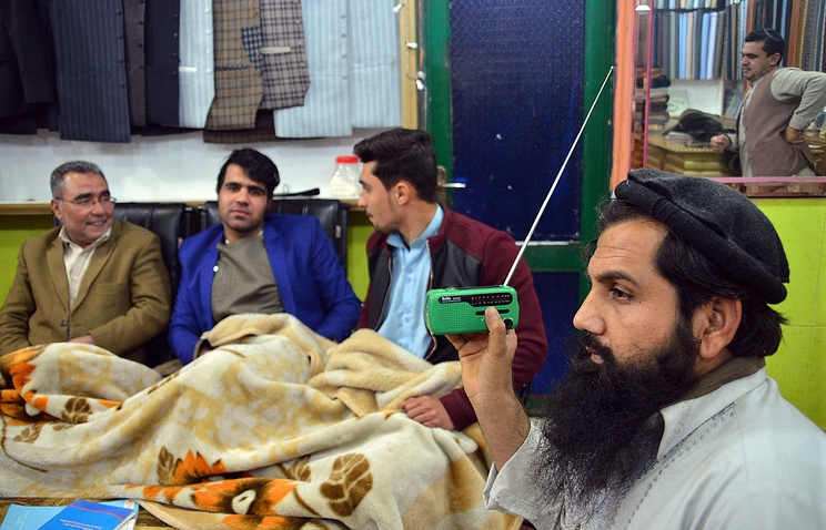 Local residents listening to Islamic State Radio in Jalalabad, Afghanistan
