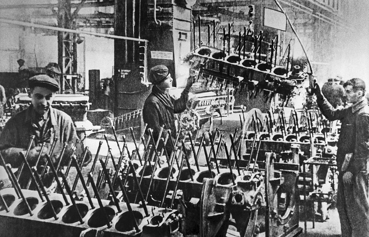 Workers of the Kirov plant assemble battle tank engines for the Red Army during the World War II