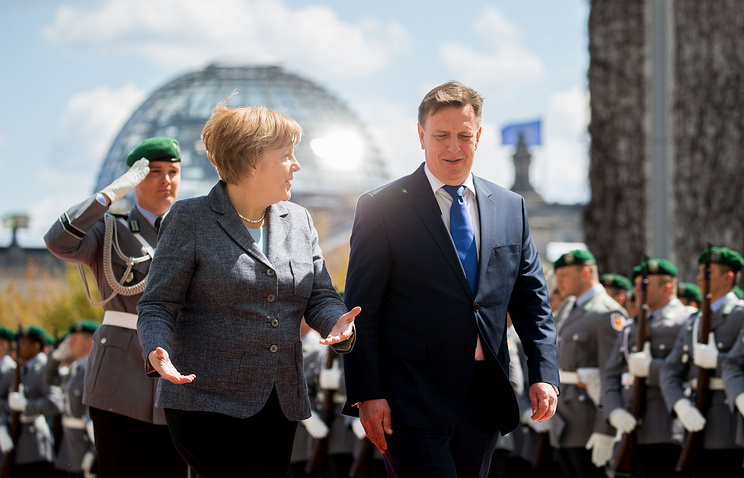 Angela Merkel and Maris Kucinskis