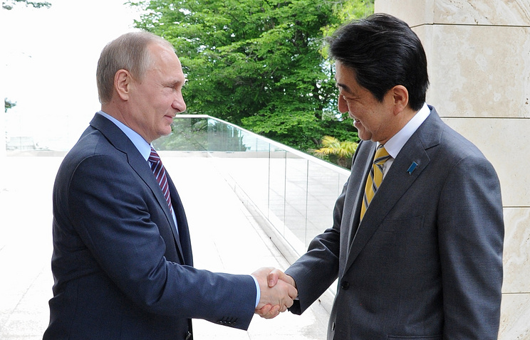 Vladimir Putin and Shinzo Abe
