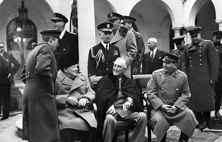 British Prime Minister Winston Churchill (sitting, left), US President Franklin Roosevelt (center) and Soviet leader Joseph Stalin (right)