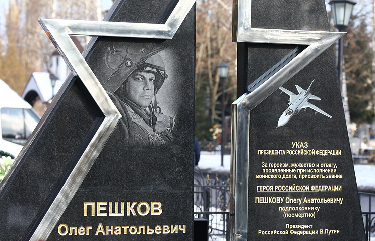A monument at the grave of Russian pilot Oleg Peshkov who was killed while flying a Sukhoi Su 24 jet during a Russian military operation in Syria