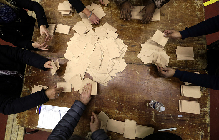 Volunteers count ballots after the conservatives primary runoff at a polling station in Marseille, southern France