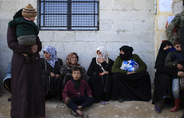 Women outside the shelter in Jibreen, Syria
