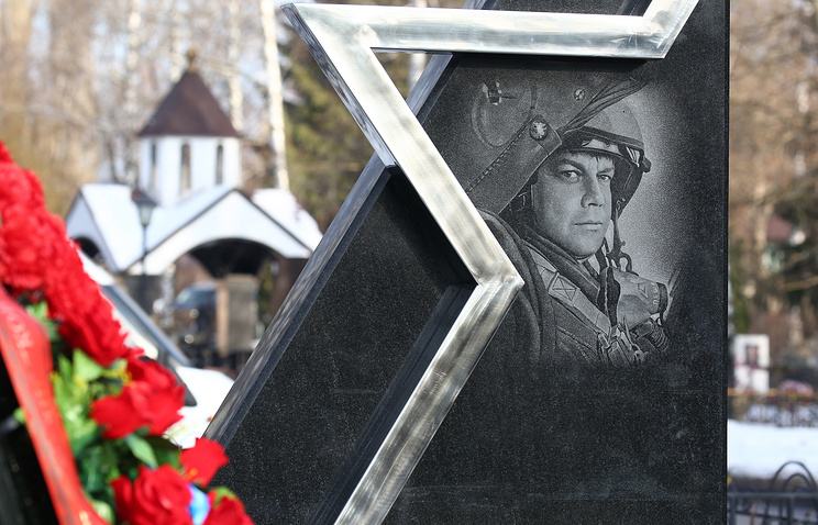 A monument at the grave of Russian pilot Oleg Peshkov