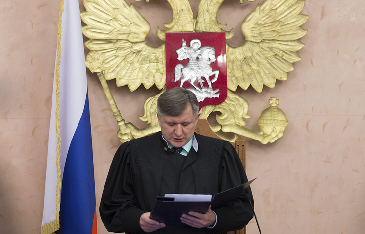 Russia's Supreme Court judge Yuri Ivanenko delivering his decision about Jehovah's Witnesses organization in Russia, April 20, 2017
