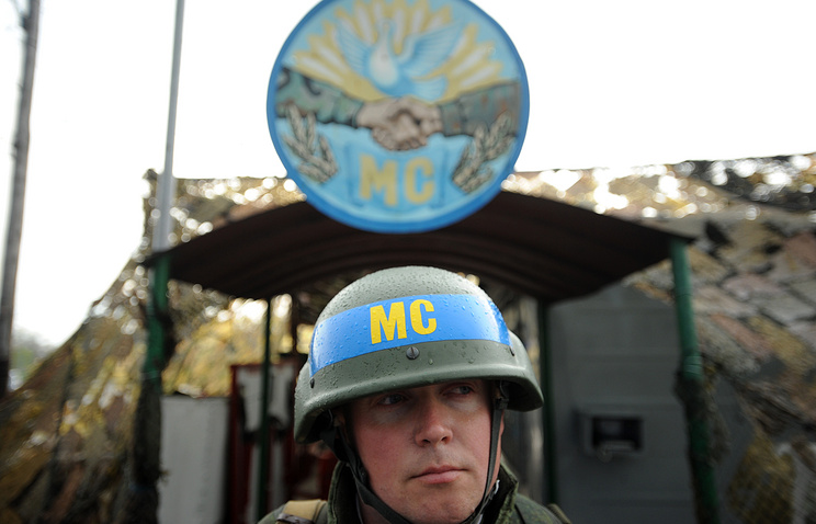 A soldier at the peacekeeping checkpoint on a bridge across the Dniester River, Bendery