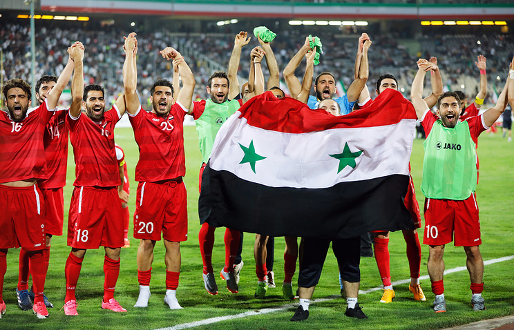 Players of Syria celebrate after the FIFA World Cup 2018 qualifying soccer match