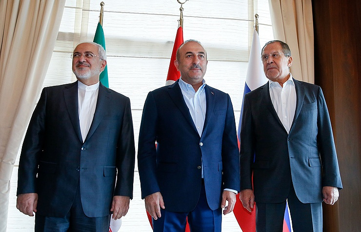 Iranian Foreign Minister Mohammad Javad Zarif, Turkish Foreign Minister Mevlut Cavusoglu and Russian Foreign Minister Sergei Lavrov meeting in Antalya