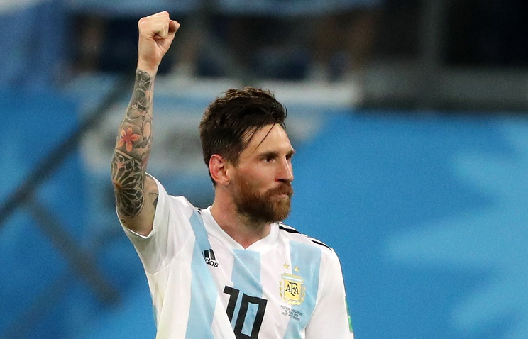Argentina's Lionel Messi celebrates his team's victory in a First Stage Group D football match between Nigeria and Argentina