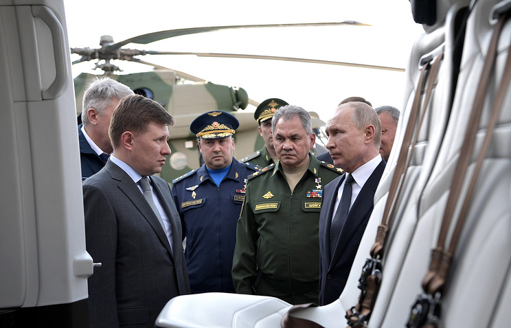 Russian Helicopters General Director Andrei Boginsky, Sergei Surovkin, commander of the Russian Aerospace Forces, Russia's Defense Minister Sergei Shoigu and Russia's President Vladimir Putin
