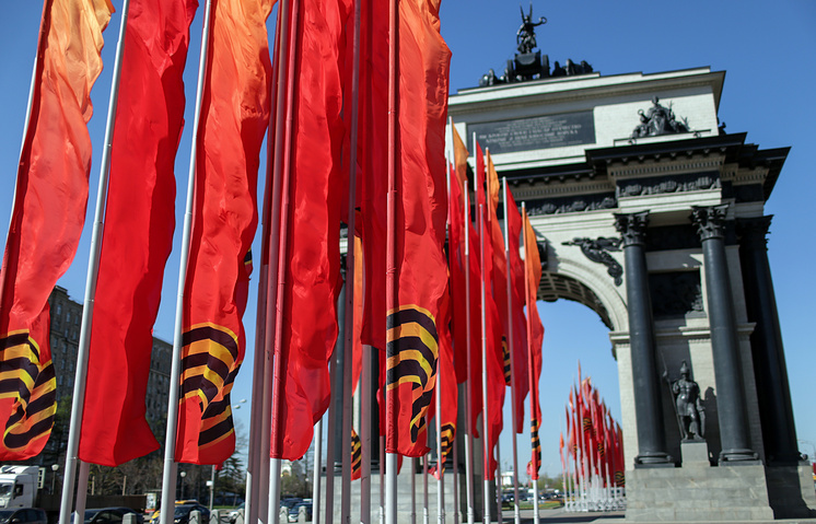 Red flags near the Triumphal Arch in Moscow's Victory Square ahead of the celebrations of the 70th anniversary of the Victory in World War II