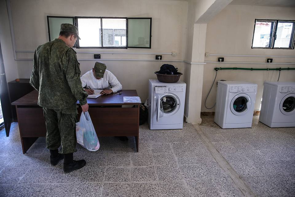 Russian soldiers in a laundry room at Hmeimim airbase, February 24, 2016 Valery Sharifulin/TASS