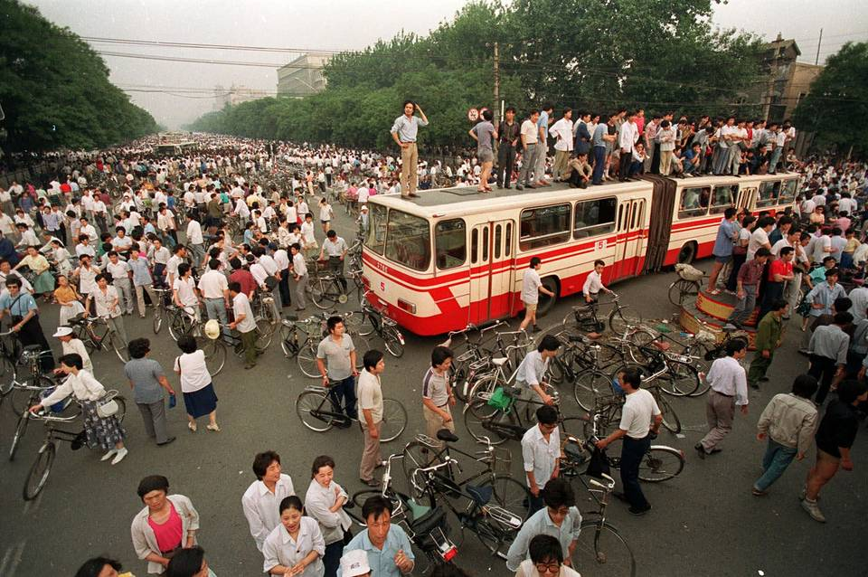 A huge crowd gathering at a Beijing intersection near Tiananmen Square, China, 1989  AP Photo/Jeff Widener