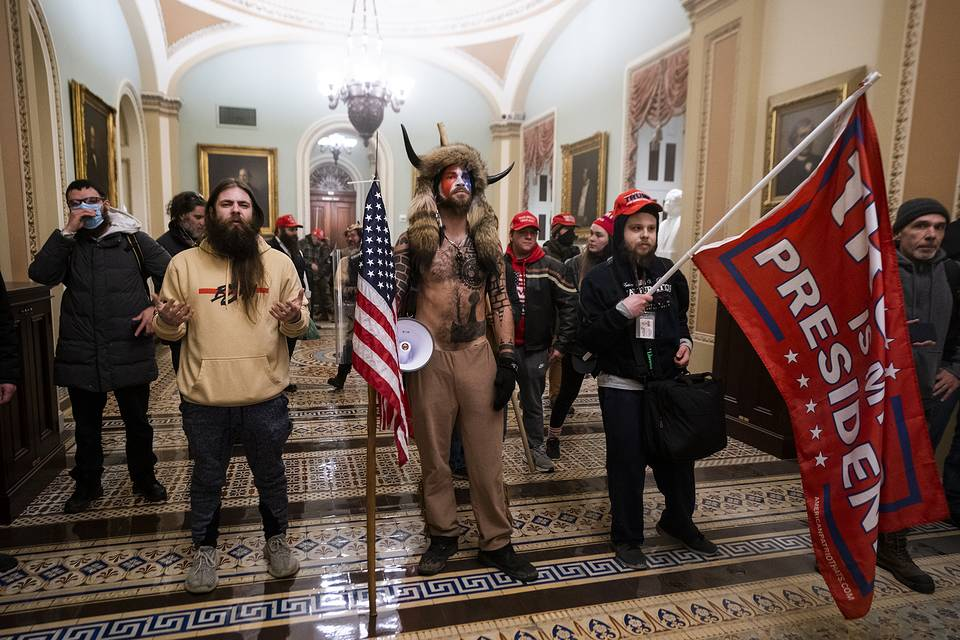 Supporters of US President Donald Trump standing by the door to the Senate chambers after they stormed the US Capitol, January 6, 2021 EPA-EFE/JIM LO SCALZO